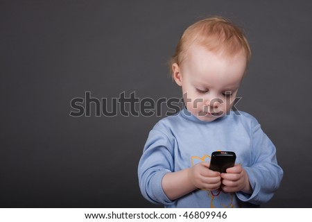 child speaks on his cell phone