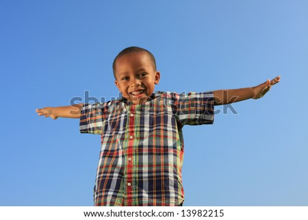 Child Spreading His Arms - stock photo