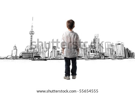 child standing in front of a cityscape - stock photo