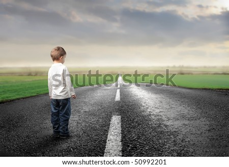 Child standing on a countryside road