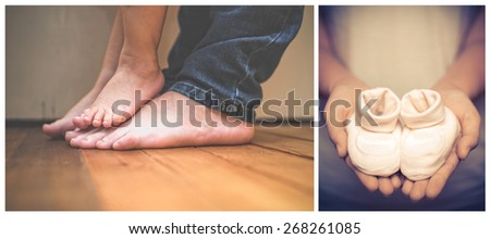 child standing on parent's feet and baby shoes - stock photo