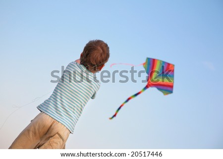 Child starting kite - stock photo