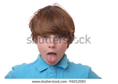Child Sticking Out his Tongue on White background - stock photo