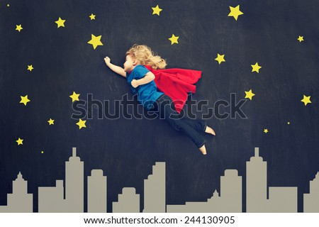 Child super hero concept with stars and skyline. - stock photo