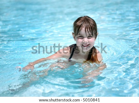 Child Swimming on a Sunny Day