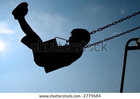 Child swinging - stock photo