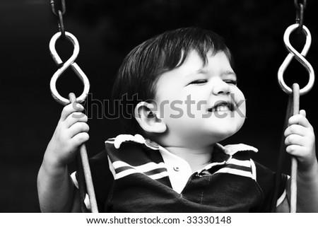 Child swinging - stock photo