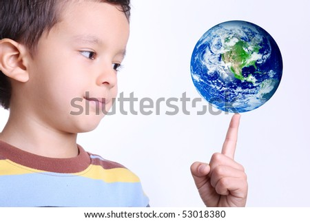 child taking the world on his finger with a gesture of happiness