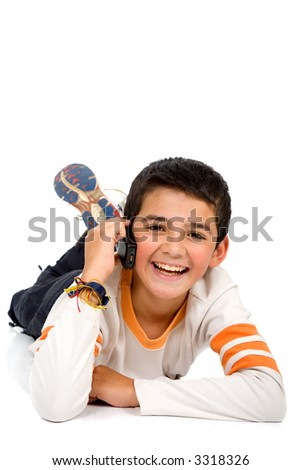 Child talking on a mobile phone isolated over a white background - stock photo