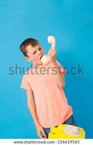 Child talking on a telephone - stock photo