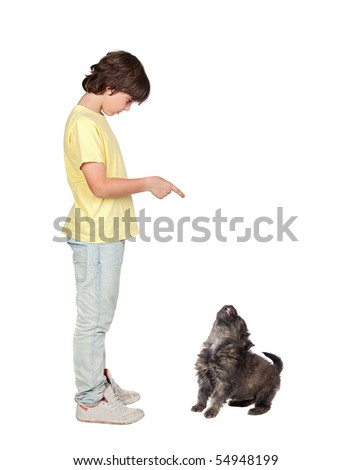 Child taught to obey his puppy isolated on white background - stock photo