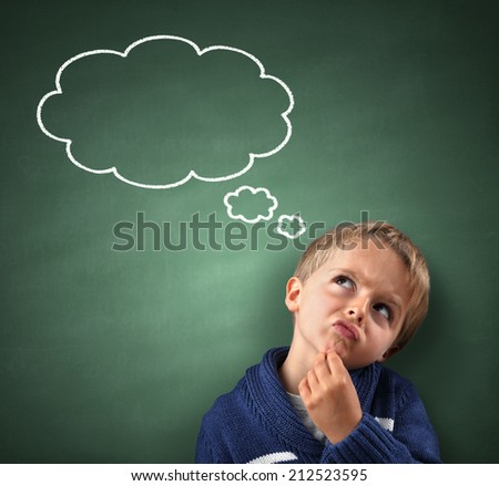 Child thinking with a thought bubble on the blackboard concept for confusion, inspiration and solution - stock photo