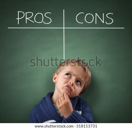 Child thinking with Pros and Cons on a blackboard concept for choice, for and against, confusion, inspiration and solution - stock photo