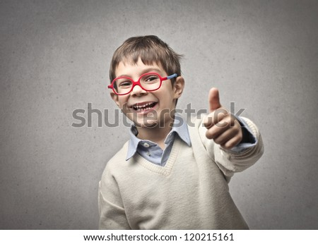 Child thumbs up - stock photo