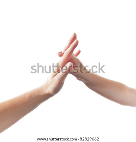Child touching hand of mother isolated on white Background