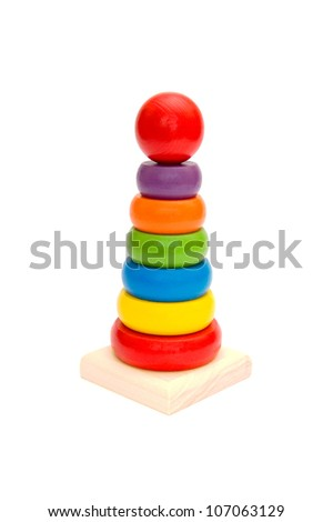 Child toy wooden colorful tower isolated on white background - stock photo