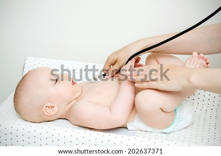 Child treated by a doctor - stock photo