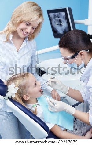 Child treated teeth in the dental clinic