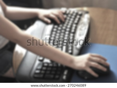 Child typing on a computer keyboard - stock photo
