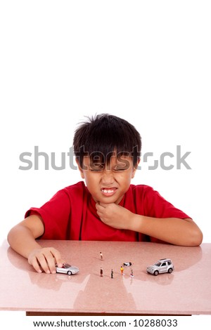 child under meditation of sore throat playing toy car - stock photo