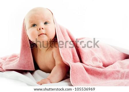 child under pink blanket - stock photo
