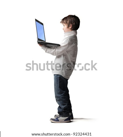 Child using a laptop - stock photo