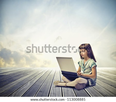 Child using a laptop computer
