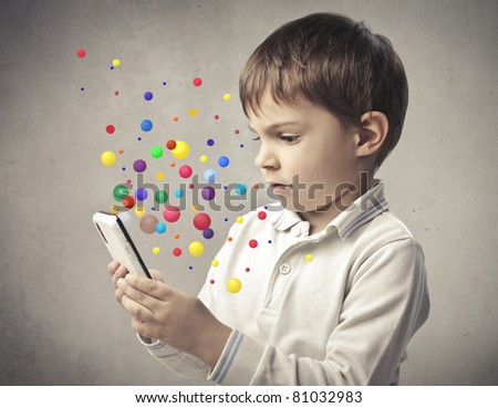 Child using a mobile phone - stock photo