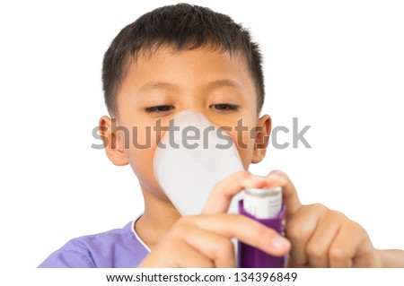 Child using inhaler for asthma on isolated - stock photo