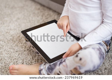 Child using tablet computer - stock photo