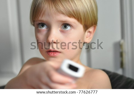 child using video game remote - stock photo