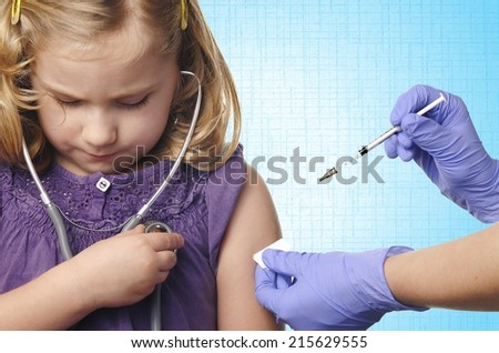 Child vaccinations on blue background. MANY OTHER PHOTOS FROM THIS SERIES IN MY PORTFOLIO.  - stock photo