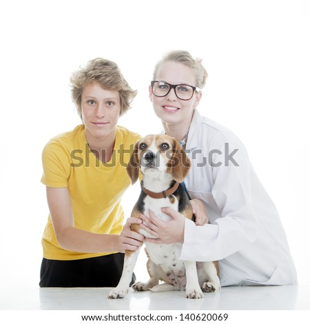 child vet and pet dog - stock photo