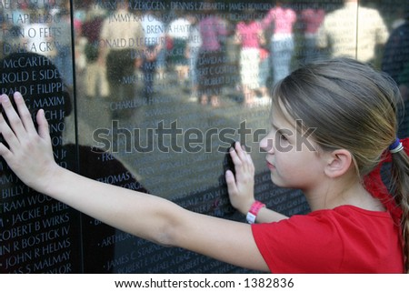 Child Viewing the Vietnam Memorial wall - stock photo