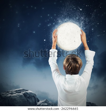 Child wants get to take the moon - stock photo