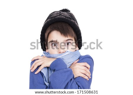 child warm in winter clothes on white background