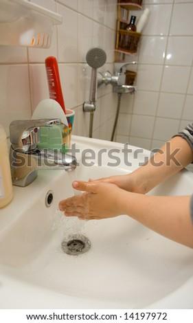 Child washing hands - stock photo