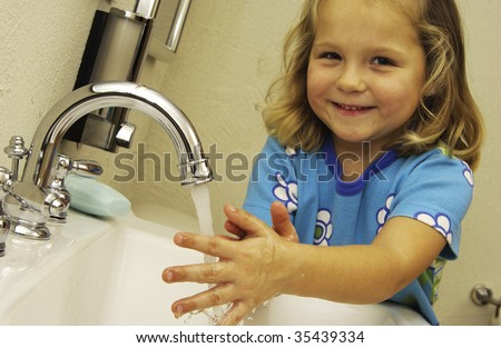 child washing hands - stock photo