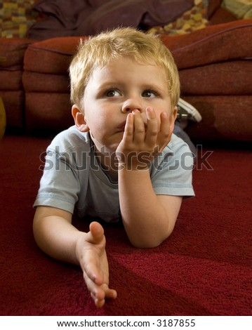 child watching TV - stock photo