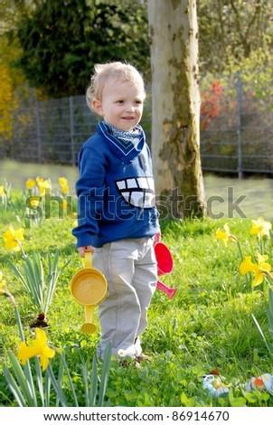 Child watering plants - stock photo