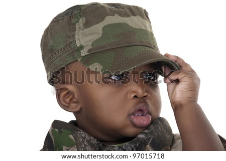 child wearing a camouflage uniform and cap on white background