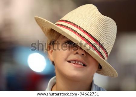 Child wearing a Fedora hat - stock photo
