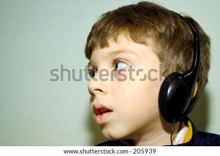 Child Wearing Headphones.