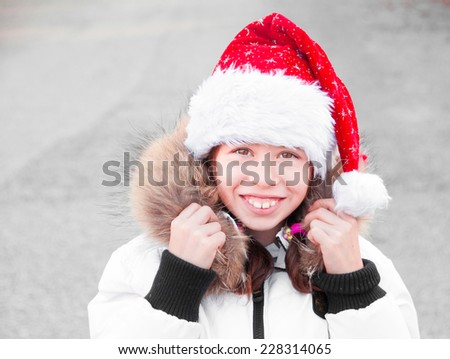 Child wearing Santa Claus hat - stock photo