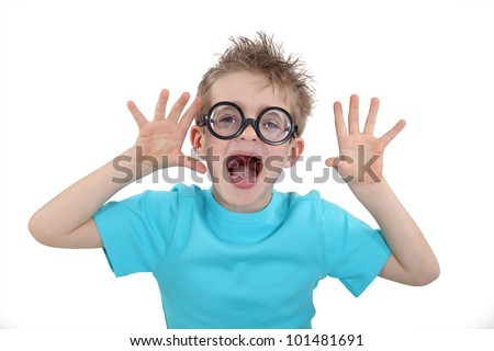 Child wearing wacky glasses and making a silly face - stock photo