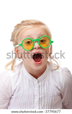 Child wears green glasses and screams into camera. Isolated on white background. - stock photo