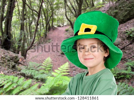 Child whit hat of Saint Patrick's Day celebration in the field - stock photo