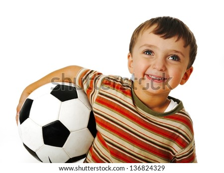Child with a ball of football - stock photo