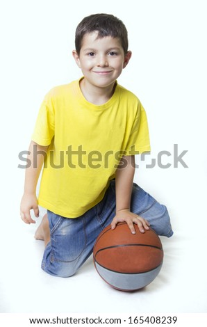 Child with a basketball ball.