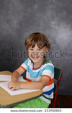 Child with a blank page, learning, school or education concept - stock photo